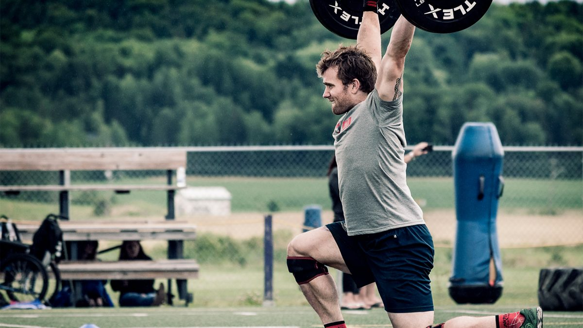 CrossFit athlete doing overhead lunges