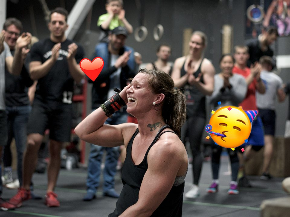 CrossFit athlete happy in the middle of the crowd