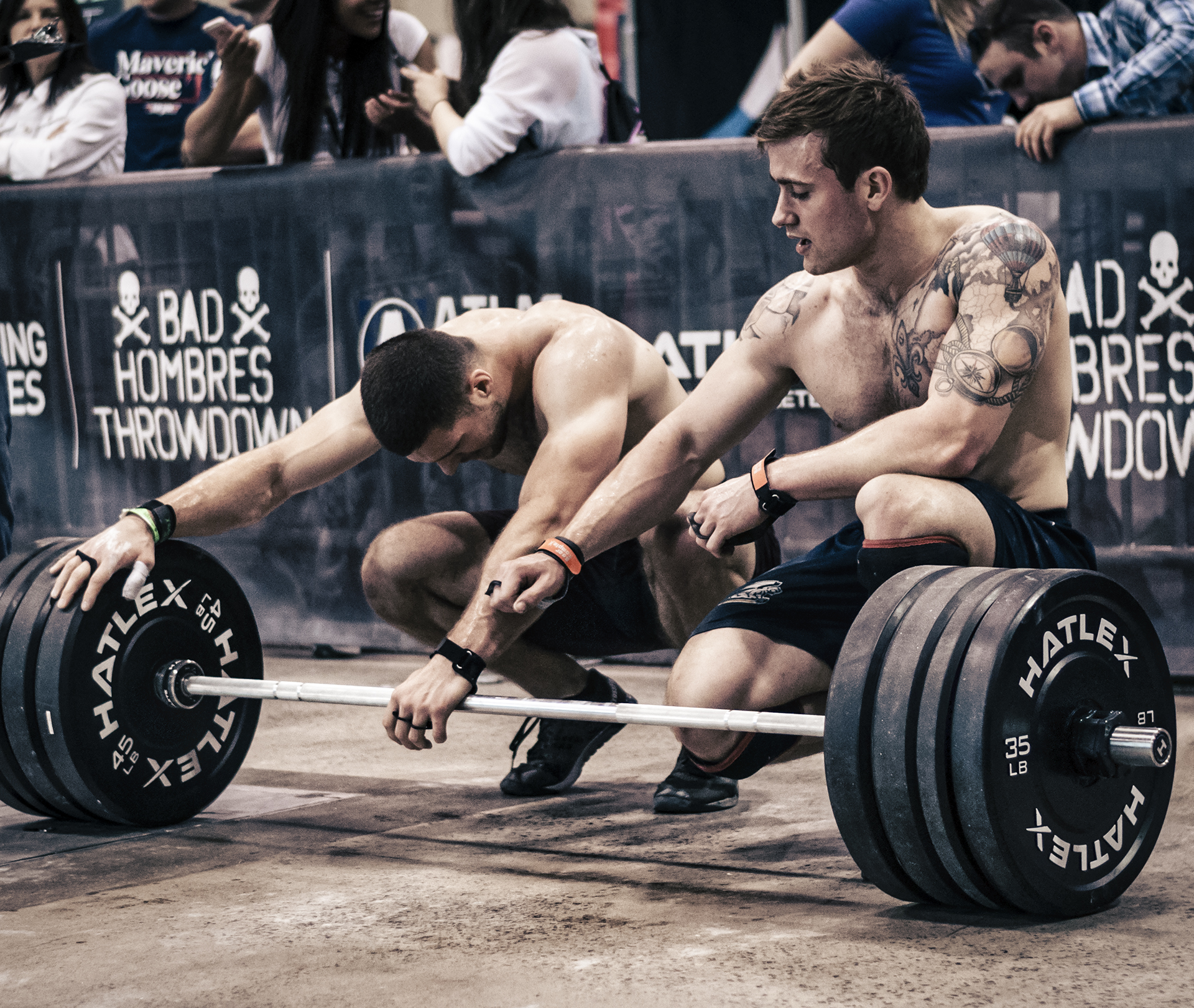 CrossFit athlete team cheering up each other