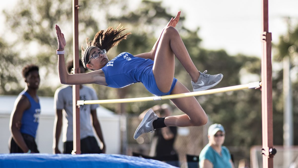 Track & field athlete jumping over a pole