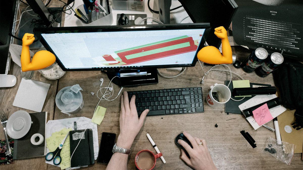 Messy ddesk office keyboard coffee monitor