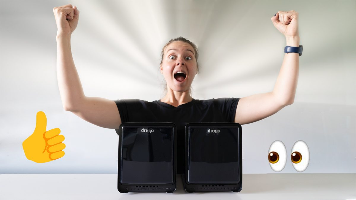 Michele Grenier photo portrait excited with Drobo devices in front of her