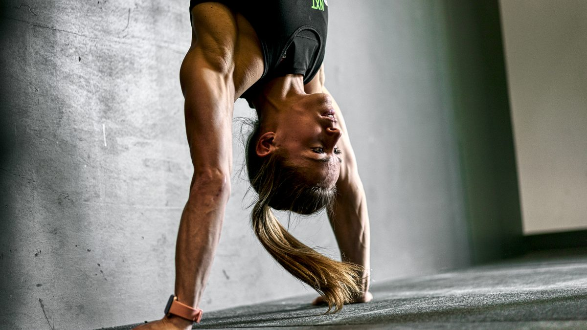 Female CrossFit athlete handstand push up