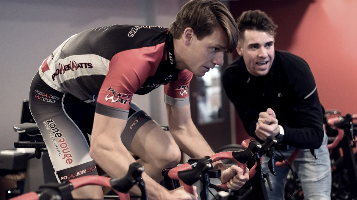 Cycling athlete spinning with coach