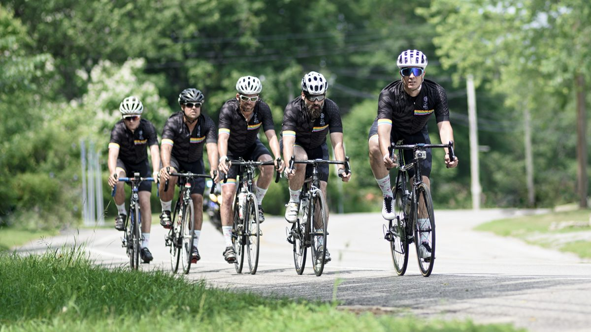 Bike riders team on the road