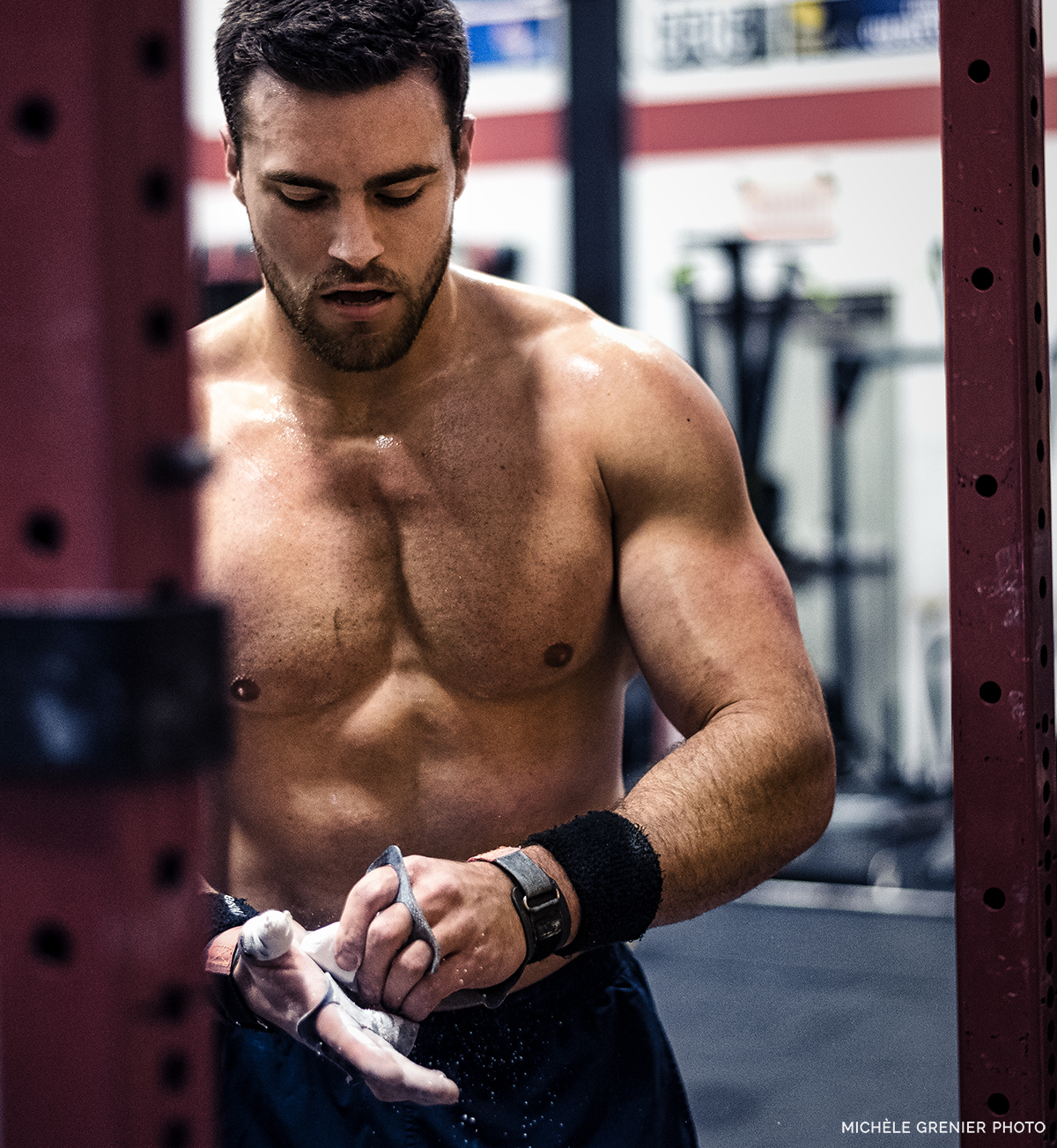 CrossFit male athlete chalking his hands