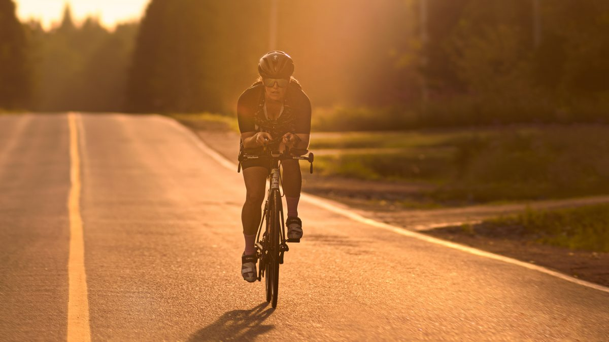 Golden hour cyclist on country road