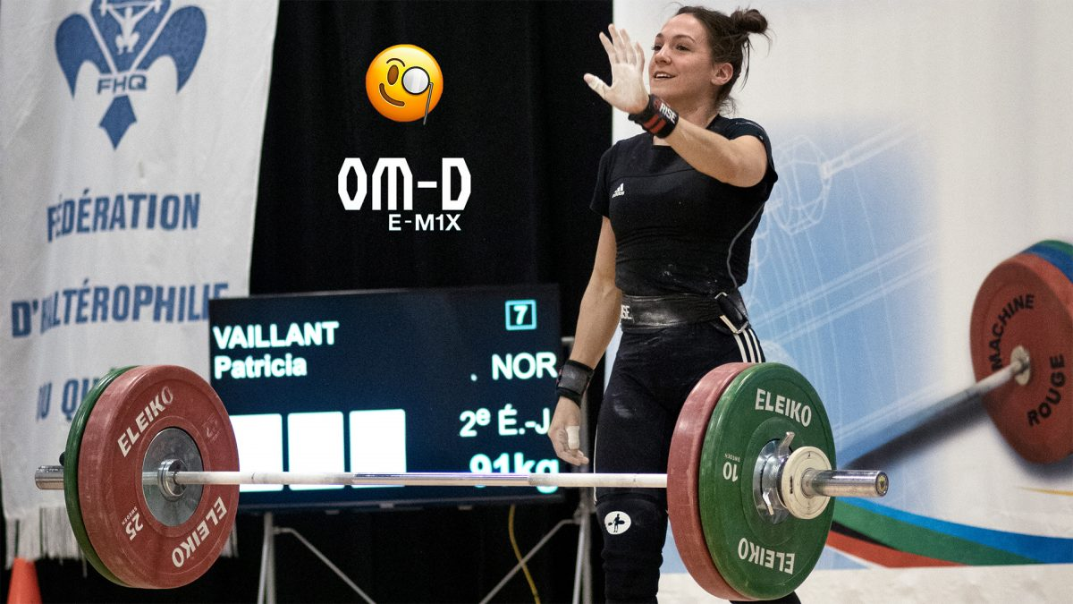 Female Olympic weightlifter smiles after her performance