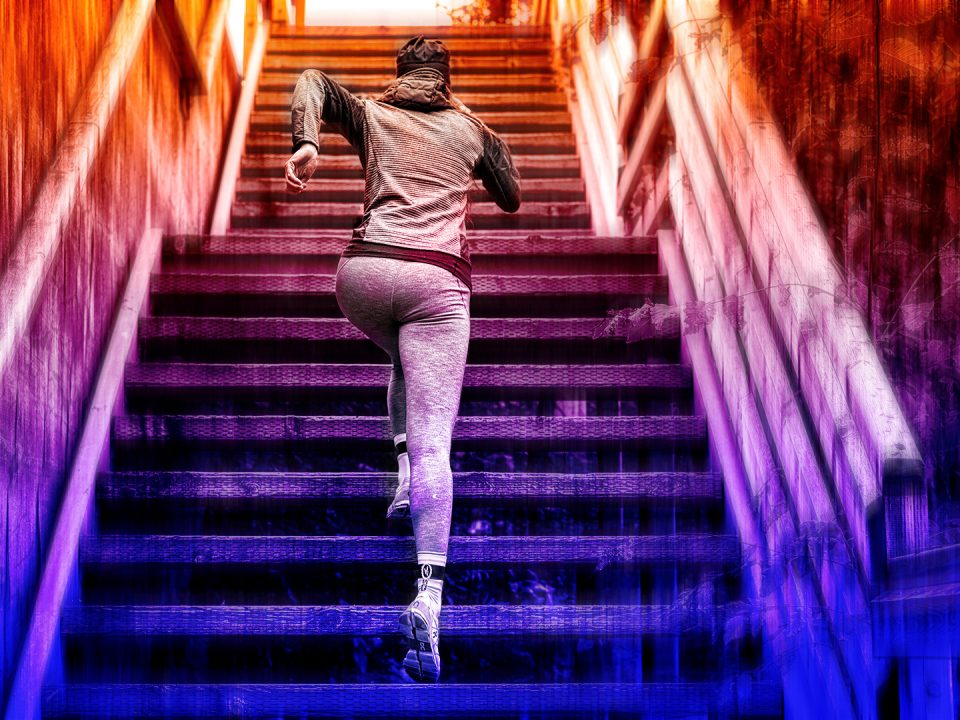 Female runner climbing up the stairs