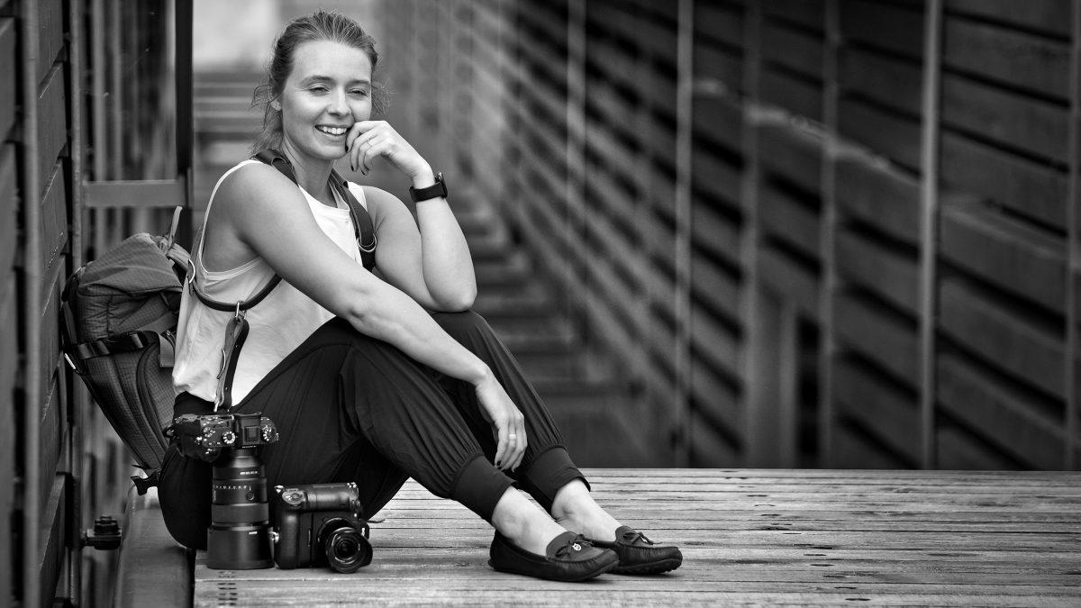 Female photographer Michele Grenier with prime lenses