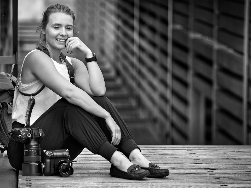 Female photographer Michele Grenier with prime lenses